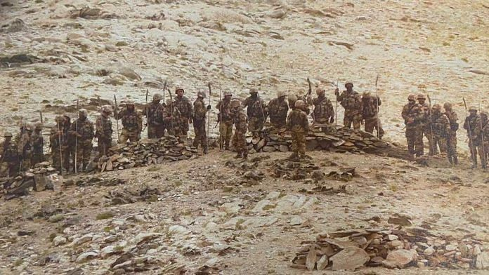 A picture showing Chinese soldiers carrying rifles and iron rods with machete-like heads near India's forward locations in Rezang La   By special arrangement
