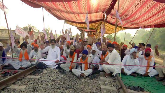 Farmers protest against the new farm laws on a railway track near Amritsar, Punjab | File photo: ANI