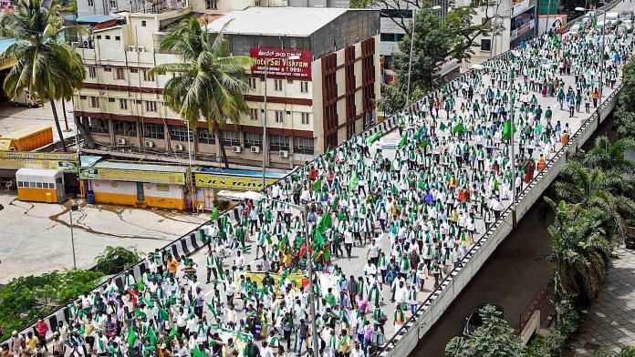 File photo | Karnataka State Farmers Association members take part in a protest rally | PTI