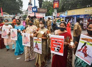 Activists of various organisations (SFI, DYFI & AIDWA) hold a candlelight vigil during a protest over the death of Hathras gang-rape victim, in Vijayawada, Wednesday, 30 September 2020 | PTI