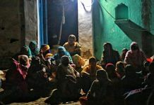 People gathered at the house of the woman who was allegedly gang-raped in Hathras, Uttar Pradesh | Photo: Manisha Mondal |ThePrint