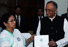 File image of West Bengal Chief Minister Mamata Banerjee and Finance Minister Amit Mitra | Photo: ANI