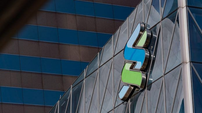 File photo of The Standard Chartered Plc logo is displayed atop the Standard Chartered Wealth Management Centre in Hong Kong
