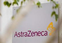 A sign featuring the AstraZeneca Plc logo stands at the company's DaVinci building at the Melbourn Science Park in Cambridge, U.K., on Monday, June 8, 2020 | Jason Alden/Bloomberg