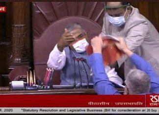 TMC MP Derek O'Brien shows the House rule book to Rajya Sabha deputy chairman Harivansh Sunday | Photo: ANI