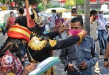 An employee of the Central Delhi district authorities patrols the roads dressed as Yamraj as part of Covid awareness campaign