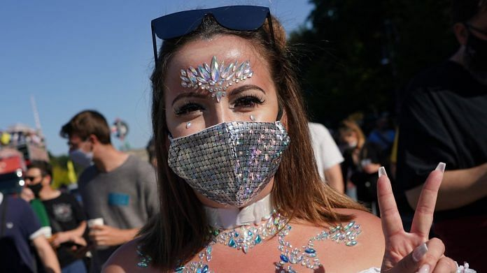 A participant at the 'Love World Peace Parade' in Berlin on 21 September