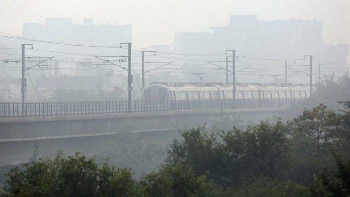 A Delhi Metro train running through the smog in November 2019 | File photo: Suraj Singh Bisht | ThePrint