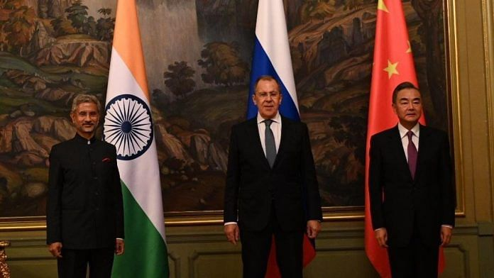 External Affairs Minister Dr. S Jaishankar with his Russian and Chinese counterparts Sergei Lavrov (C) and Wang Yi (R) during the meeting of the Foreign Ministers of the Shanghai Cooperation Organization, in Moscow on Thursday.   ANI