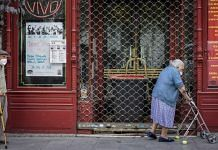 An elderly couple walk past a closed cafe in Plaza del Angel in Madrid, Spain | Representational Image | Bloomberg