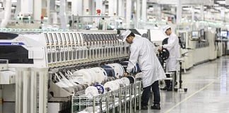 Employees work on the assembly line of a Huawei Technologies Co. mobile phone plant in Dongguan, China | Bloomberg