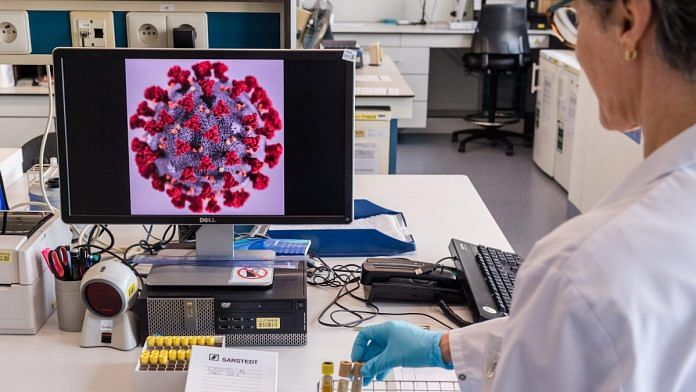 Representational image | A magnified coronavirus germ is displayed on a monitor during coronavirus patient sample detection tests in the virology research labs in a hospital in Leuven, Belgium | Bloomberg