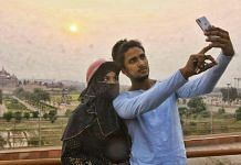 A Muslim couple clicks selfie in front of the Akshardham temple | Photo: Praveen Jain | ThePrint