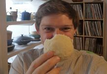 British lecturer Edward Anderson poses with an idli, in a photo he posted on his Twitter account | @edanderson101 | Twitter