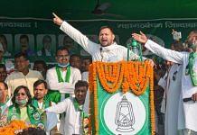 Rashtriya Janata Dal (RJD) leader Tejashwi Prasad Yadav addresses an election campaign rally ahead of the Bihar Assembly polls, in Gaya district, Sunday, Oct. 18, 2020. | PTI