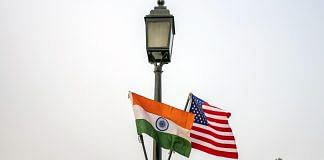 The national flags of India and US hang from a lamppost in New Delhi