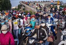 Workers make their way to the factories in Van Trung Industrial Park in Bac Giang Province | Bloomberg
