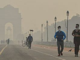 Fitness enthusiasts walk at Rajpath amid hazy weather conditions, in New Delhi, Monday, Oct. 26, 2020 | PTI