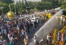Police personnel use water cannons to disperse farmers during a massive protest against the new farm bills, in Sirsa district, Tuesday, Oct. 6, 2020 | PTI