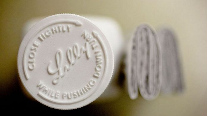 An Eli Lilly & Co. logo can be seen on the cap of a pill bottle |  Daniel Acker |  Bloomberg