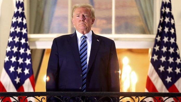 Donald Trump stands on the Truman Balcony after returning to the White House from Walter Reed National Military Medical Center   McNamee/Getty Images via Bloomberg