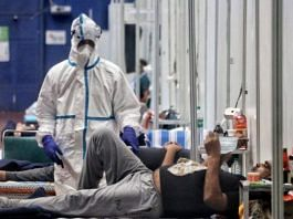 A health worker wearing PPE suit tends to Covid-19 patients in New Delhi | Representational image | ANI File Photo