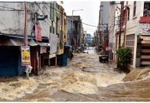 Floodwater gushes through a street following heavy rains, at Falaknuma, in Hyderabad, Wednesday, 14 October, 2020.| PTI