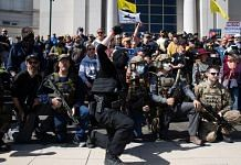 Demonstrators in 'tactica gear' at Michigan Supreme Court building during a Second Amendment March in Lansing, Michigan, U.S., on Thursday, Sept. 17, 2020 | Representational image | Emily Elconin | Bloomberg