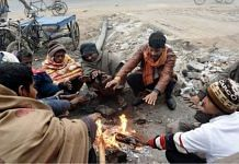 Men sitting by a fire | Representational image | ANI