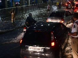Vehicles wade through a flooded street in Hyderabad on Tuesday evening | ANI