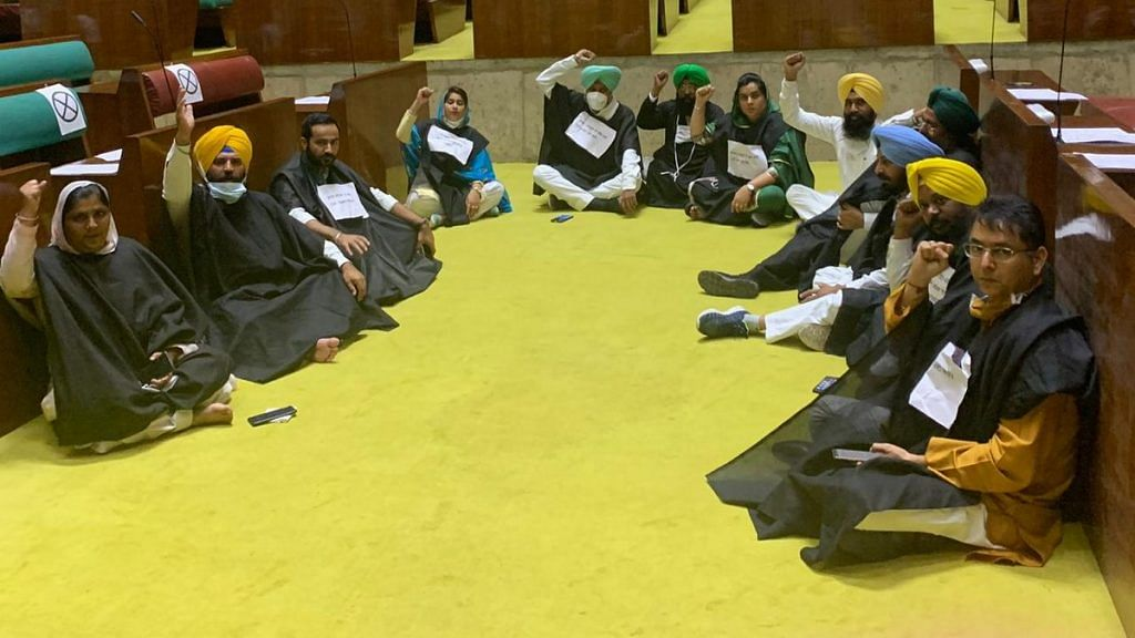 AAP MLAs demonstrate on the floor of the Punjab assembly, demanding to see a copy of the legislation that Captain Amarinder Singh's govt plans to introduce Tuesday | By special arrangement