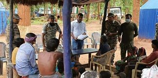 Security personnel and villagers at a newly opened police camp in Narayanpur.   Photo: Special arrangement