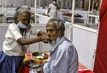 An old woman helps husband in eating   Photo: Praveen Jain   ThePrint