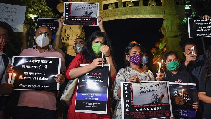 File photo | Activists hold placards and light candles demanding justice for the Hathras 'gang-rape' victim, in Mumbai | PTI
