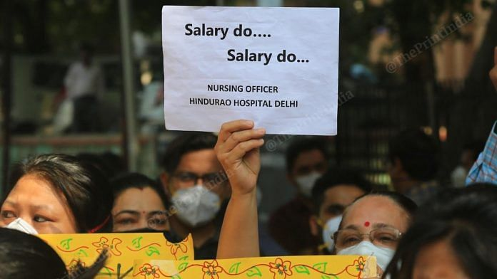 Hindu Rao Hospital doctors and nurses, who are on Covid duty, protesting outside the hospital Wednesday against NDMC over non-payment of dues. | Photo: Suraj Singh Bisht/ThePrint