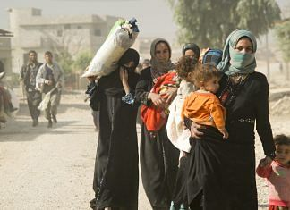 Muslim women walk with their children in Iraq (Representational image) | Commons