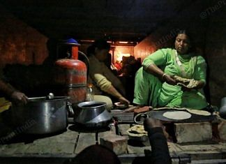Women sitting in the trucks make chapattis | Photo: Manisha Mondal | ThePrint