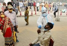 A health worker conducts COVID-19 RAT test at Anand Vihar Bus Terminal, New Delhi | PTI