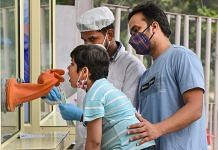 A health worker collects swab samples for Covid-19 test, in New Delhi 9 November 2020. | PTI/Kamal Kishore