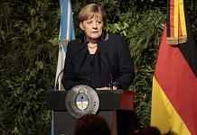 File photo of Germany's chancellor Angela Merkel speaking during an official dinner | Photographer: Sarah Pabst | Bloomberg