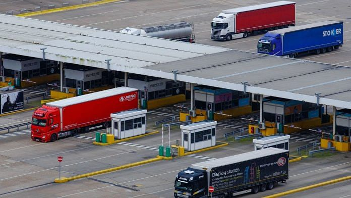 Freight lorries queue through a customs border control point at the Port of Dover Ltd. in Dover, UK | Luke MacGregor | Bloomberg