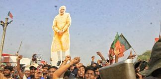 A BJP supporter seen holding a placard of Narendra Modi during the election rally in Darbanga   Praveen Jain   ThePrint