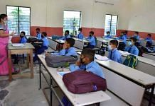 Students attend a class after schools re-opened in Nagaon district of Assam on 2 November 2020   ANI