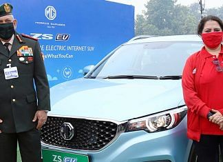 Chief of Defence Staff Gen. Bipin Rawat (left) and BJP MP Meenakshi Lekhi with an MG electric vehicle in New Delhi | Photo: Twitter | @MGMotorIn