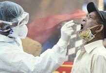 A man undergoes a Covid-19 test in New Delhi | PTI
