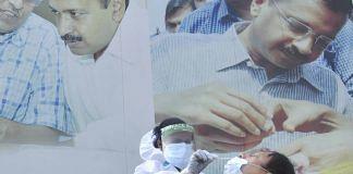 A health worker conducts Covid test outside a mohalla clinic in Delhi, 20 Nov 2020 | PTI