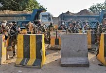 BSF and CISF personnel along with barricades and barbed wire deployed at the Singhu border in north Delhi to prevent farmers from marching into the national capital | Photo: Manisha Mondal