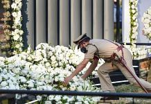 A policeman pays tribute to martyrs at Police Memorial during the 12th anniversary of the 26/11 Mumbai terror attacks, in Mumbai   PTI Photo/Kunal Patil