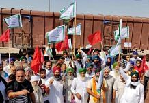Punjab farmers protesting against the Modi government's farm laws in front of a goods train at Phillaur railway station   File photo: ANI