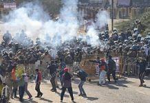 Delhi Police use tear gas on protesting farmers at Singhu border Friday | Photo: Manisha Mondal | ThePrint
